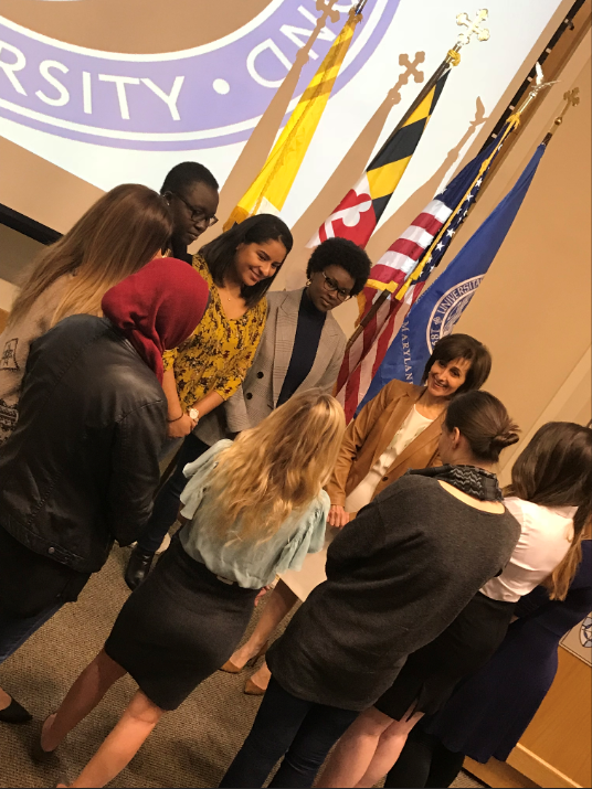 Dina Kawar speaks with a group of students