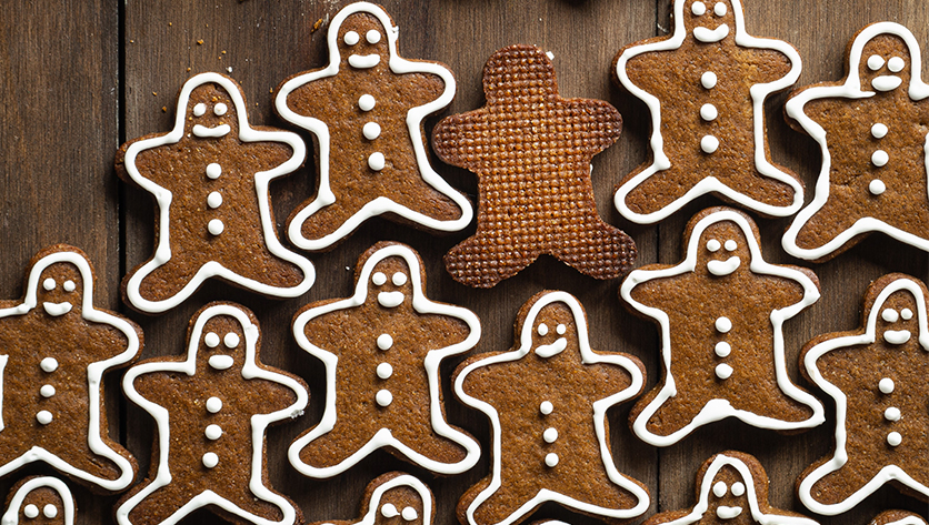 gingerbread men cookies on table - Photo by Oriol Portell on Unsplash