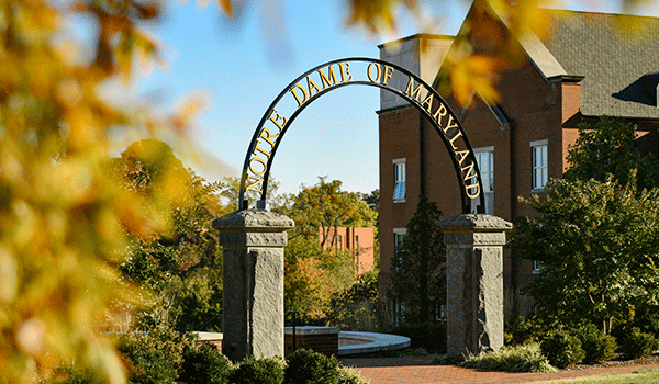 NDMU Arch surrounded by fall leaves