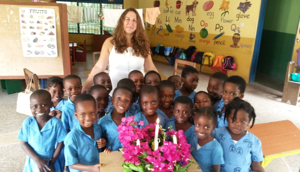 Student teacher in Africa with a class of small children