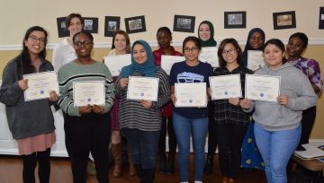 Group of students holding certificates of recognition
