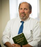 Bill Davis holding a book
