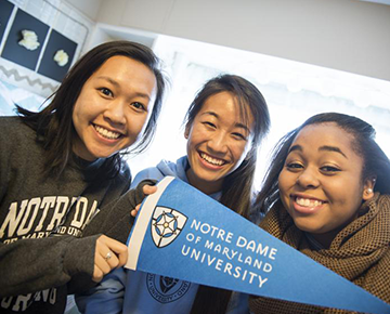 Students holding a Notre Dame pennant