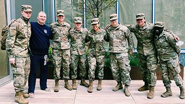 Ricelle Taganas, NDMU student, poses with her Army Reserves team in fatigues in NYC