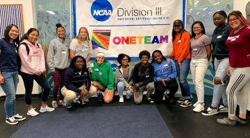 a group of people in front of NCAA and one team logo