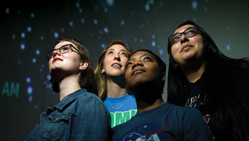 students in NDMU planetarium