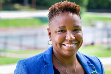 Renee Bostic - Athletic Director - headshot outside smiling