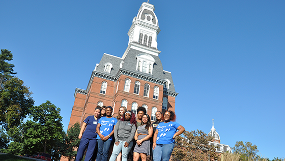 Students stand in front of Gibbons Hall