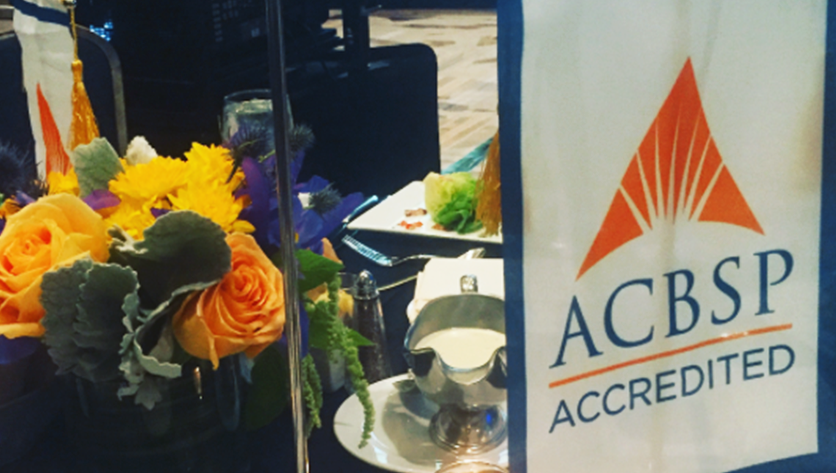ACBSP Accredited table set up with flowers