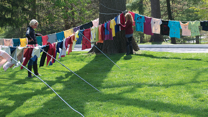 Clothesline with color t-shirts hanging outside with messages on them