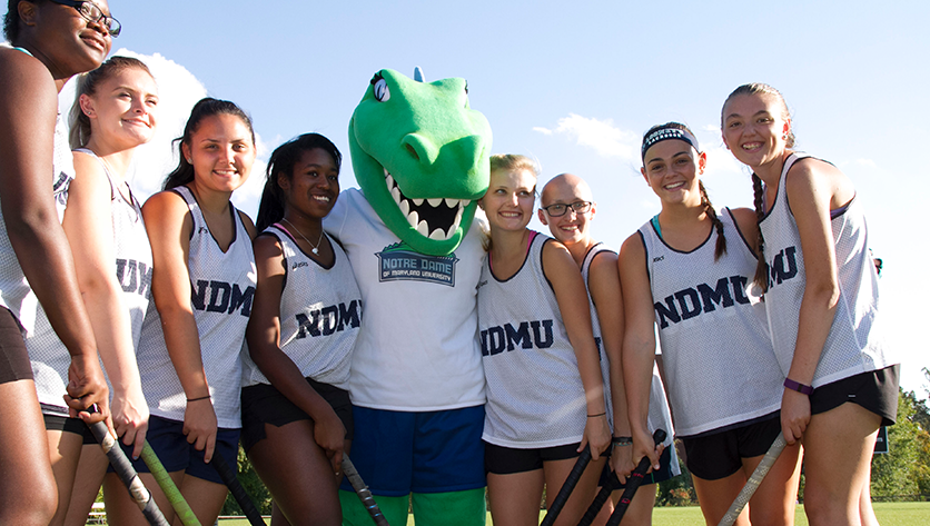 NDMU lacrosse team with Gabby the Gator
