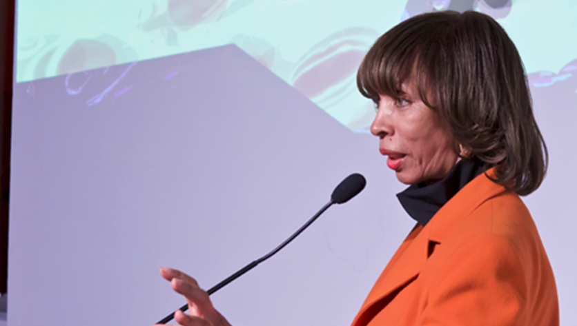 Mayor Catherine E. Pugh speaking into a microphone