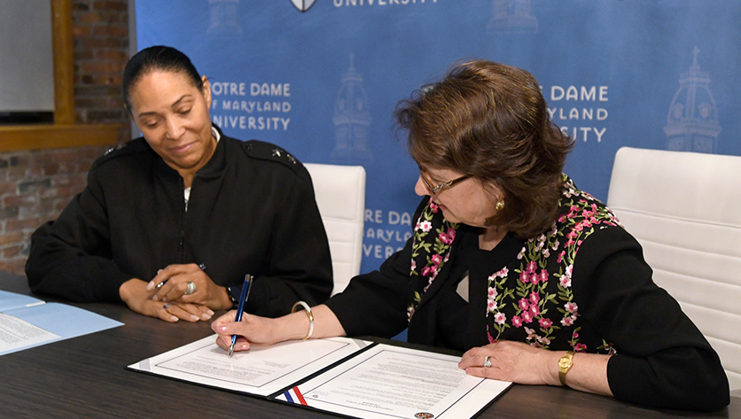 Dr. Yam & Maj. Gen. Linda L. Singh sign partnership