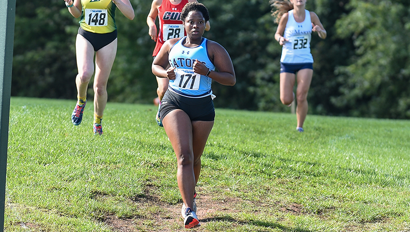 Tavia Williams runs in Cross Country race