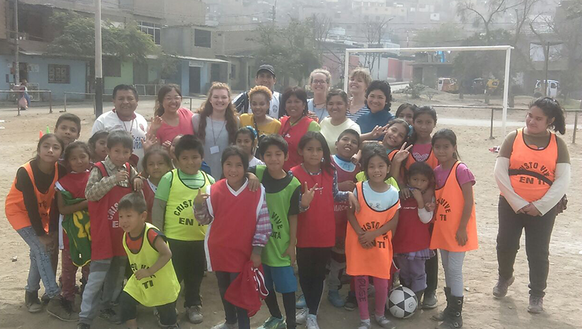 V Cox with students in Peru