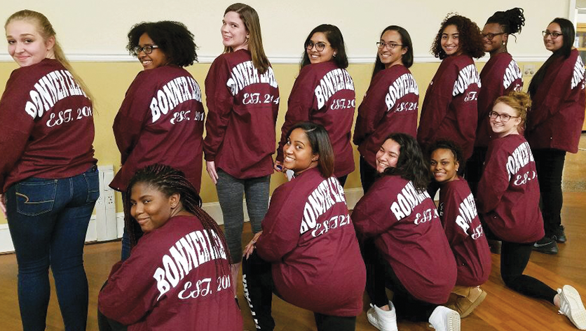 Group photo of bonner leaders looking over their shoulder wearing bonner shirts