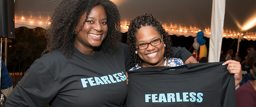 "Two women wearing ""fearless"" shirts"