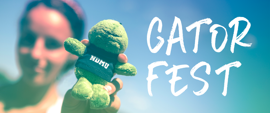"Girl holding NDMU stuffed gator ""Gator Fest"""