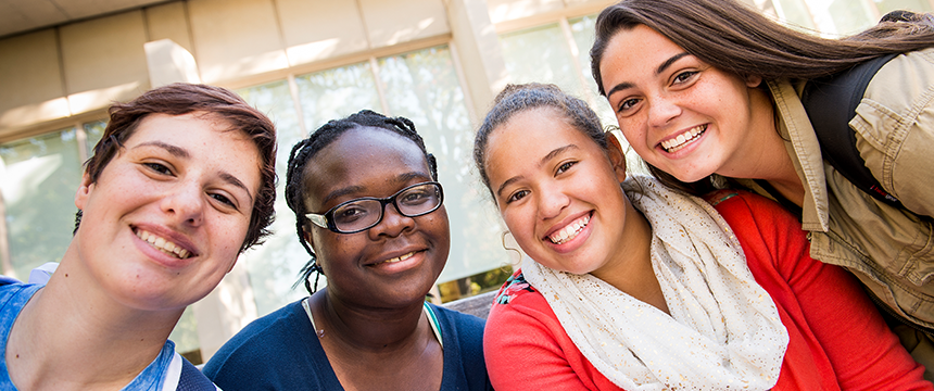 Close up of four smiling female students
