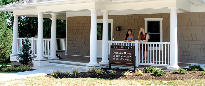 Two women standing on the porch of the Otenasek House