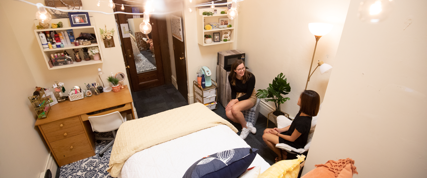 two girls chatting in the dorm