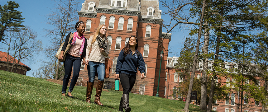 Students walking in front of Gibbons Hall