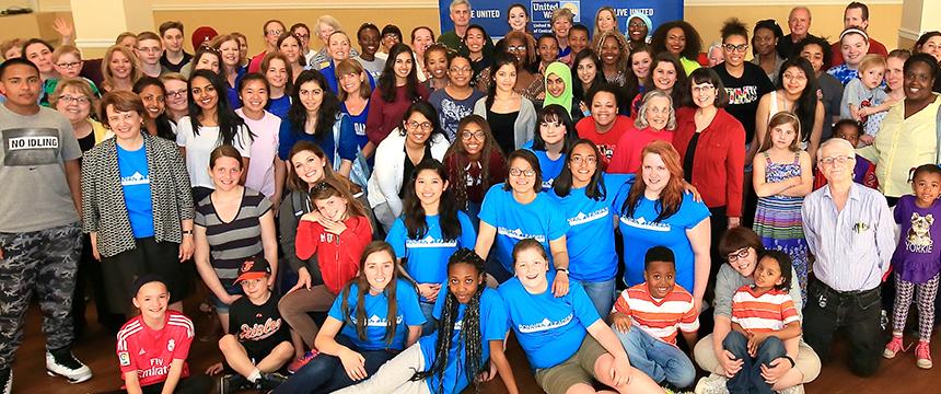 Large group photo of service participants
