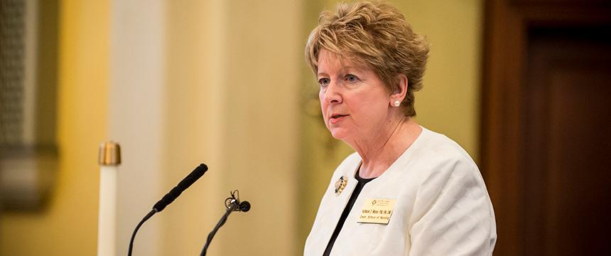 Dean Kathleen Wisser speaks into a microphone