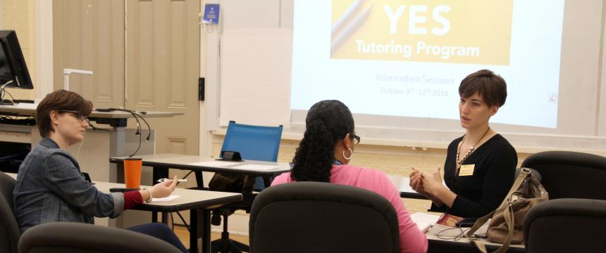 3 students sitting in a classroom learning about the yes program