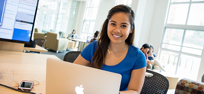 Female student working on a laptop