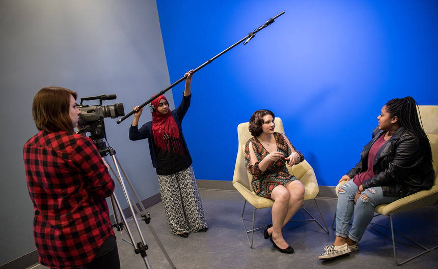 group of comm arts students filming an interview