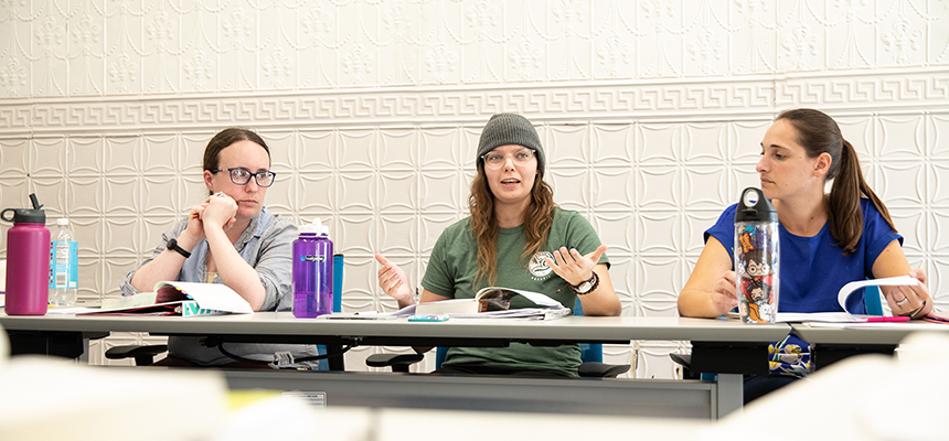 Three students having a class discussion
