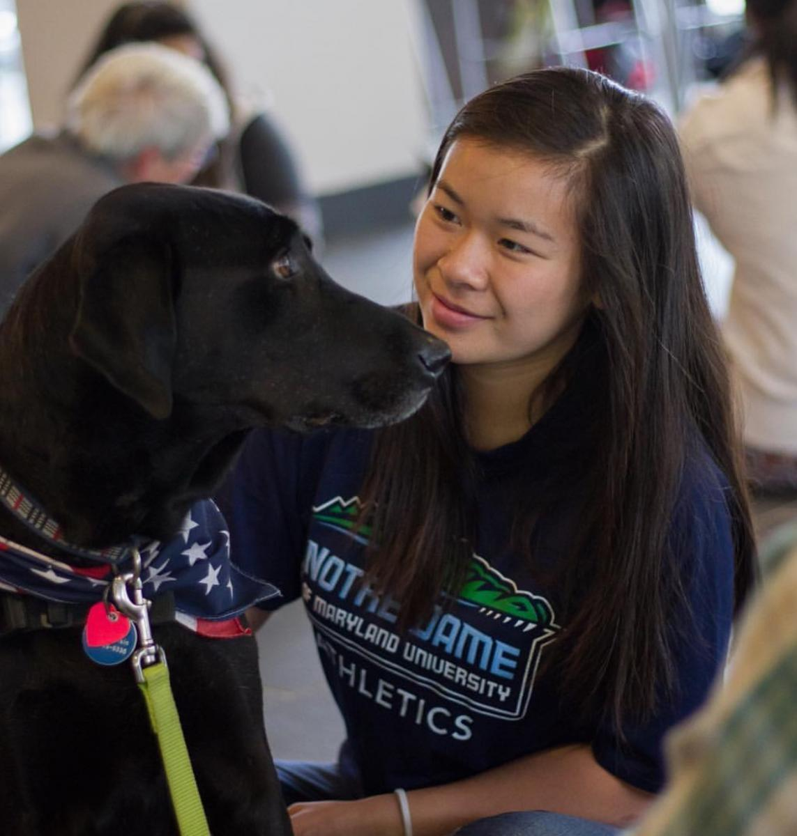 therapy dog with student