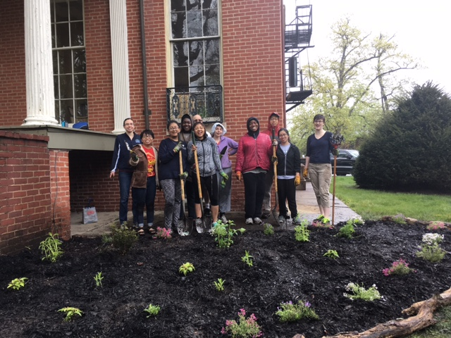Students at the completed pollinator garden