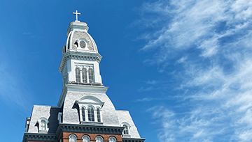 gibbons hall tower with blue skies