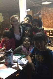 V Cox with children in Peru